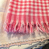 Vintage Textiles. A pink gingham fringed towel is on top of a cotton cloth with a crocheted edge Royalty Free Stock Images