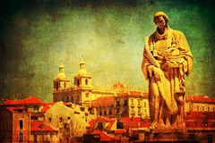 Vintage textured cityscape of Lisbon with old statue. Vintage textured cityscape of Lisbon, Portugal, with an old statue of a seafarer and discoverer in the Stock Photography
