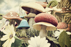 Vintage textured garden of mushrooms Royalty Free Stock Photo