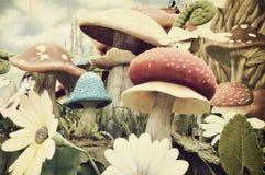 Vintage textured garden of mushrooms royalty free stock photo