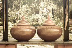 Vintage Thai art jar,sepia color Stock Photos