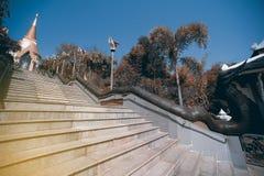 Vintage Thai art on staircase to Golden Pagoda in Wat Pa Phu Kon. Royalty Free Stock Photo