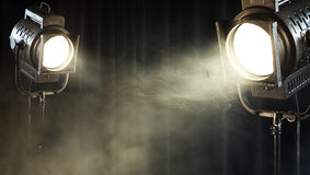 Vintage theater spot light on black curtain. With smoke Royalty Free Stock Image