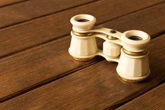 Vintage theatre binoculars on an old wooden table stock images