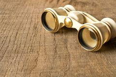 Vintage theatre binoculars on an old wooden table stock photos