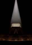 Vintage theatre stage with white spotlight. stock image