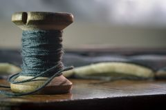Vintage thread bobbin background, concept of traditional sewing, close up view stock photos