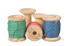 Vintage thread reels. Vintage wooden reel of thread on white Stock Image