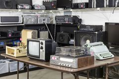 Vintage Thrift Store Electronics Area. Vintage consumer electronics inside a funky thrift antique store Royalty Free Stock Photography