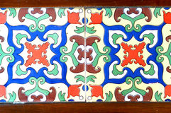 Vintage tile. Colorful vintage tile in white, red, blue and green royalty free stock photo