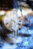 A vintage timepiece frozen under water. royalty free stock photography