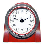 Vintage timer. In red isolated on white background Royalty Free Stock Photo