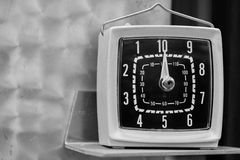 Vintage timer on metal shelf Stock Photos
