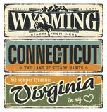 Vintage tin sign collection with America state. Wyoming. Connecticut. Virginia. Retro souvenirs on rust background. American flag. Royalty Free Stock Photography