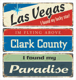 Vintage tin sign collection with USA cities. Las Vegas. Clark County. Paradise. Retro souvenirs or postcard templates on rust back. Ground stock illustration