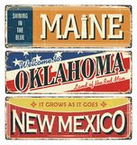 Vintage tin sign collection with USA state. Maine. Oklahoma. New Mexico. Retro souvenirs or postcard templates on rust back stock illustration