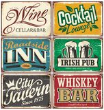 Vintage tin signs collection with various drinks and beverages themes. On old rusty background. Wine cellar and bar, cocktail lounge, roadside inn, Irish pub Royalty Free Stock Images