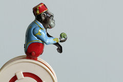 Vintage tin toy. Vintage toy with tin monkey holding apple on plastic wheel Royalty Free Stock Photography