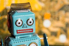Vintage tin toy robot with computer circuit board background, artificial intelligence concept Stock Image