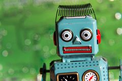 Vintage tin toy robot with computer board, artificial intelligence concept Stock Photo
