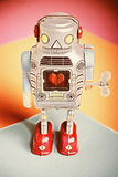 Vintage Tin Windup Robot  with heart in center Stock Images