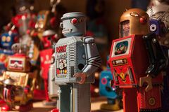 Vintage tinplate robots on display at HOMI, home international show in Milan, Italy. MILAN, ITALY - SEPTEMBER 13: Vintage tinplate robots on display at HOMI Royalty Free Stock Images