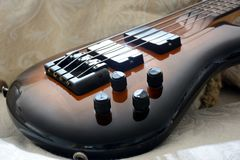 Vintage Tobacco Bass Guitar. 4 Strings Tobacco Bass Guitar with black accessories royalty free stock image