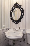 Vintage toilet with a mirror Royalty Free Stock Photo