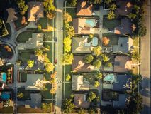 Filtered image residential dwelling units with swimming pool in fall season near Dallas, Texas. Vintage tone aerial vertical view residential houses with stock photos