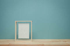 Vintage tone of Blank picture frame at the desk Stock Photos