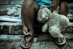 Vintage tone,boy sitting alone with old teddy bear Royalty Free Stock Photo