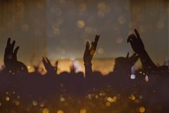 Vintage tone of christian music concert with raised hand.  Stock Photography