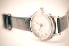 Vintage tone of close up wrist watch , selective focus Royalty Free Stock Photos
