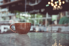 Vintage tone of cup of coffee on table in Coffee shop Stock Image
