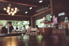 Vintage tone of cup of coffee on table in Coffee shop Royalty Free Stock Photography