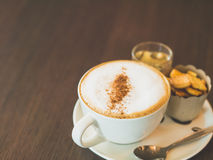Vintage tone of cup of hot capuchino coffee. Stock Images