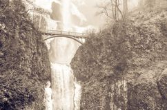 Vintage tone icy lower tier Multnomah Falls Oregon in wintertime royalty free stock image