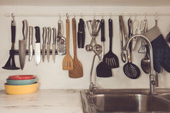 Vintage tone of Kitchen cooking utensils on rack Royalty Free Stock Photography