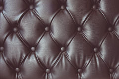 Vintage tone of leather texture with buttoned pattern royalty free stock images