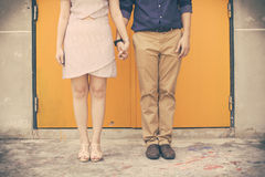 Vintage tone of Male and female legs during a date Stock Photos