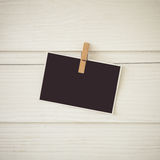 Vintage tone ofpostcard hanging on a rope and wood wall Royalty Free Stock Photography