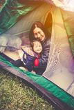 Vintage tone photo of happy family looking at camera on camping Royalty Free Stock Photography