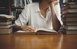 Vintage tone of Reading a book concept stock photography