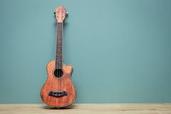 Vintage tone of still life with ukulele Old  wall Stock Photo