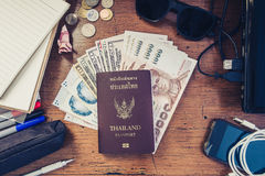 Vintage tone, travel preparation objects on desk, passport, cash, gadget and etc. Royalty Free Stock Photos