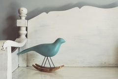 Vintage tone of Wood carving of a bird Stock Photo