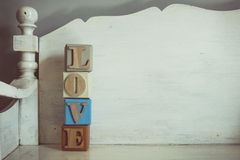 Vintage tone of word LOVE spelled out on a row of lettered. A Vintage tone of word LOVE spelled out on a row of lettered Royalty Free Stock Photography