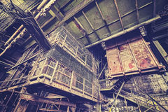 Vintage toned abandoned industrial interior. Stock Photos