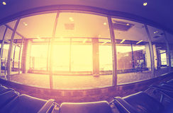 Vintage toned airport waiting room at sunset Royalty Free Stock Photography