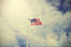 Vintage toned American flag against sun Stock Photography